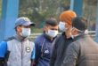 People wearing facemasks are seen outside an isolation ward opened as a preventative measure following a SARS-like virus outbreak which began in the Chinese city of Wuhan, at the North Bengal Medical college and Hospital in Siliguri on February 4, 2020. - The new coronavirus that emerged in a Chinese market at the end of last year has killed more than 360 people and spread around the world. (Photo by DIPTENDU DUTTA / AFP);أشخاص يرتدون أقعنة واقية في الهند