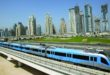 epa01853354 Dubai's metro train speeds past a backdop of dozens of high rise buildings during a final test run some hours before the opening ceremony in Dubai, United Arab Emirates on 09 September 2009. Dubai was later  opening the first metro system hoping to capture the world's spotlight on the catchy date of 9/9/09, although some of it's stations are not completed yet. The Dubai Metro will eventually become the world's longest driverless train system with more than 70km (43 miles) of track with total cost  around Dh28 billion ($7.6 billion)  EPA/ALI HAIDER