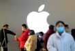 FILE PHOTO: People wearing protective masks wait for checking their temperature in an Apple Store, in Shanghai, China, as the country is hit by an outbreak of the novel coronavirus, February 21, 2020. REUTERS/Aly Song/File Photo