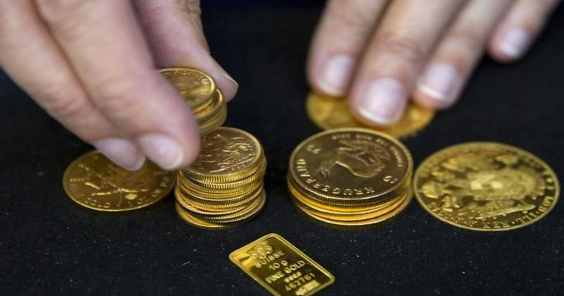 يمكن استبدالها بالدولار والدهب.. إطلاق أول عملة رقمية ذهبية في دبي